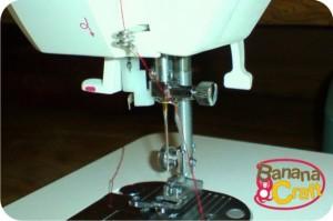 linha na máquina de costura singer